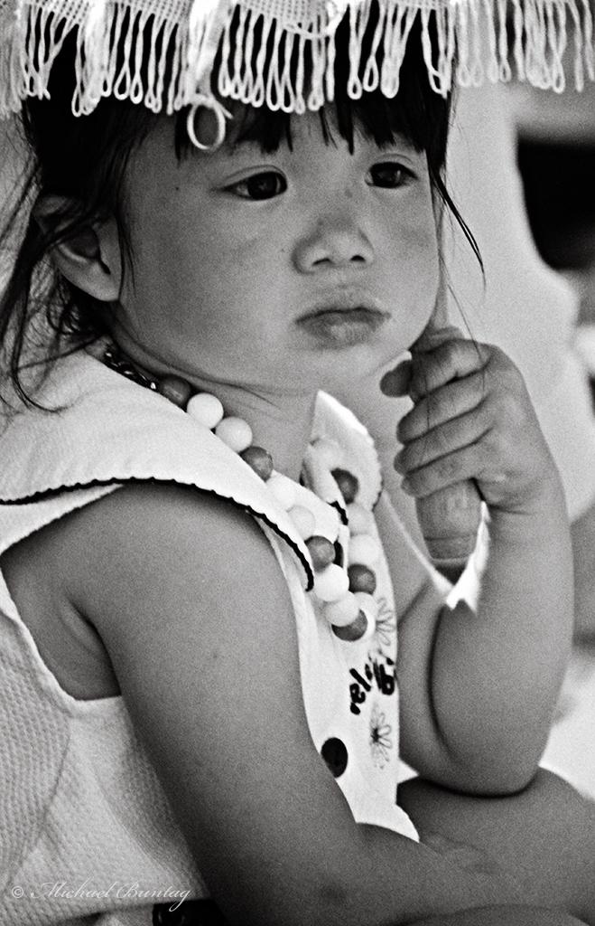 Child, Nisei Week 2001 Grand Parade, Little Tokyo, Los Angeles, California. Nikon N90s SLR, Ilford HP5+ 35mm BW film