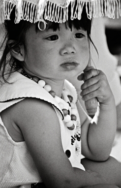 Child, Nisei Week 2001 Grand Parade, Little Tokyo, Los Angeles, California. Nikon N90s SLR, Ilford HP5+ 35mm BW film