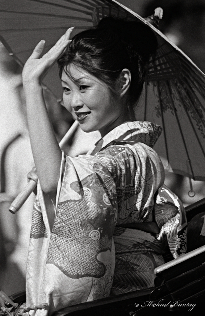 Woman in Yukata, Nisei Week 2001 Grand Parade, Little Tokyo, Los Angeles, California. Nikon N90s SLR camera, Ilford HP5+ 35mm BW film.