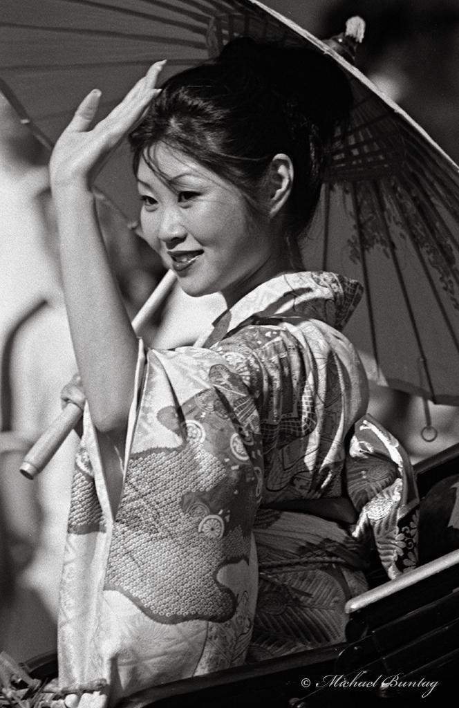 Woman in Yukata, Nisei Week 2001 Grand Parade, Little Tokyo, Los Angeles, California. Nikon N90s SLR camera, Ilford HP5+ 35mm BW film.