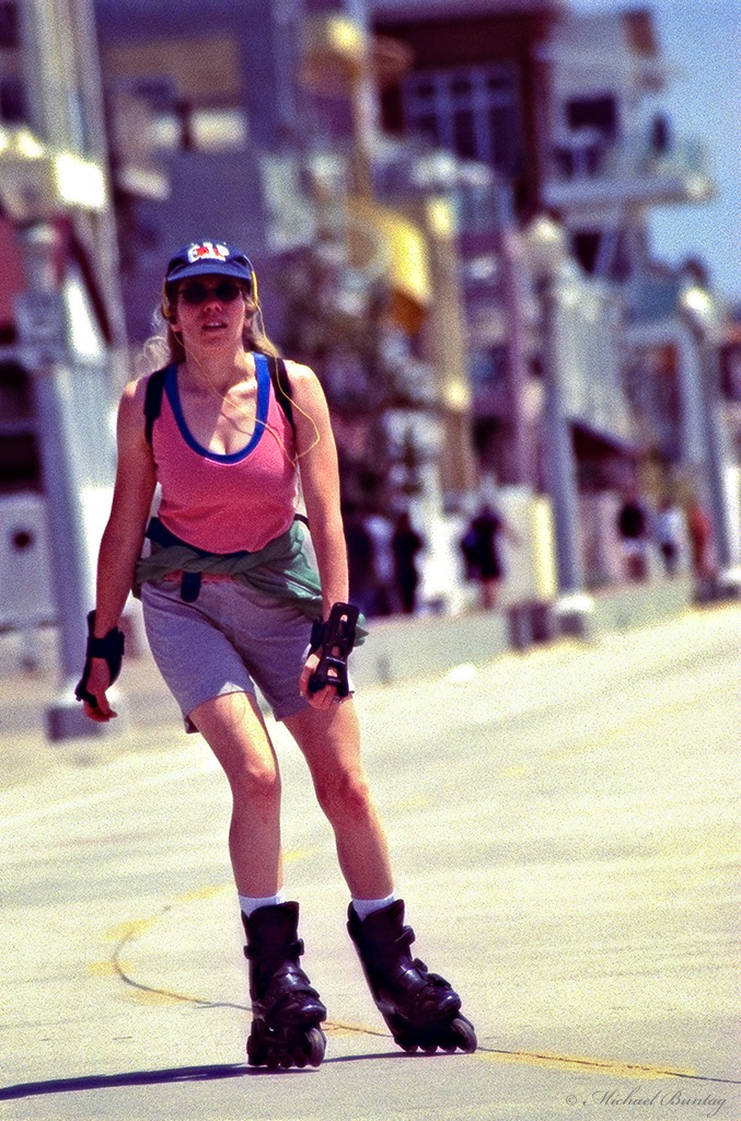 Inline Skater (Rollerblader), bicycle path (Strand), Santa Monica Beach and Pier, Los Angeles, California. Fujifilm RHP III Provia 400 35 mm Positive slide film cross-processed.