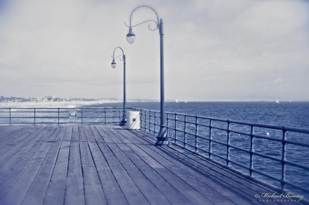 Santa Monica Beach and Pier, Santa Monica, Los Angeles, California. Kodak Ektachrome 160T (Tungsten) positive slide 35mm film. Blue filtered.