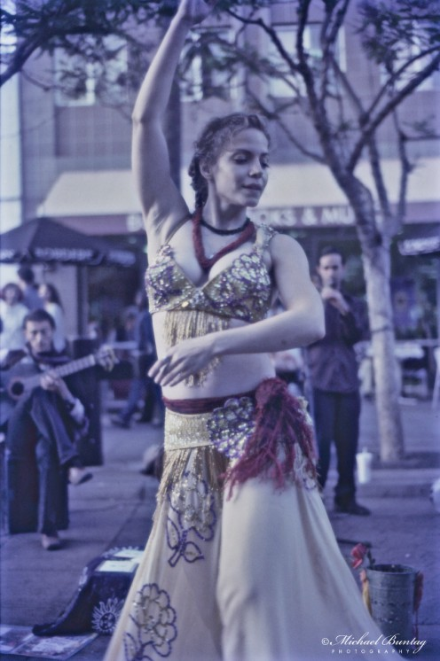 Gypsy Dancer, 3rd Third Street Promenade, Santa Monica, Los Angeles, California. Kodak Ektachrome160T (Tungsten) positive slide 35mm film. Blue filtered.
