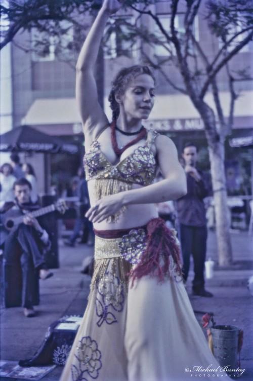 Gypsy Dancer, 3rd Third Street Promenade, Santa Monica, Los Angeles, California. Kodak Ektachrome160T (Tungsten) positive slide 35mm film. Blue filtered.