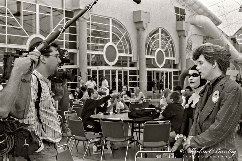 Joker, Harley Quinn (DC) cosplayers, Comic-Con International, San Diego Convention Center, Marina District, San Diego, California. Ilford HP5+ Black and White 35mm negative film.